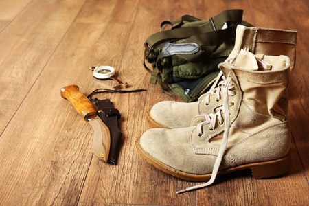 Hunting boots, backpack, and knife