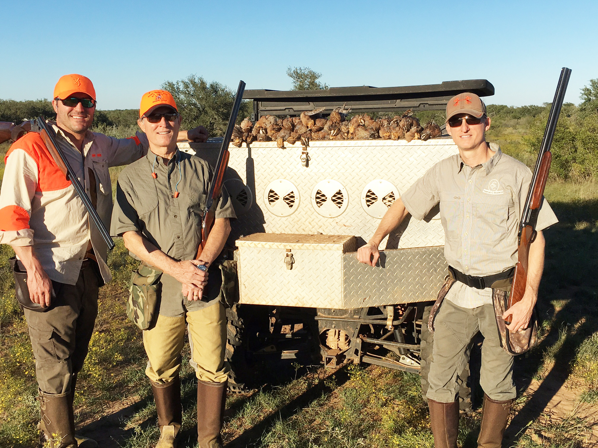 three quail hunters in Texas